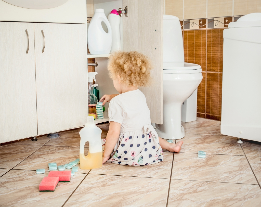 Toddler playing with chemicals she retrieved from the bathroom cabinet