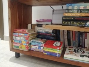 tv cabinet filled with books