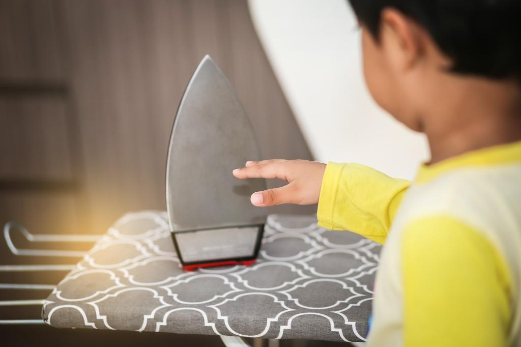 Boy dangerously touching a hot iron
